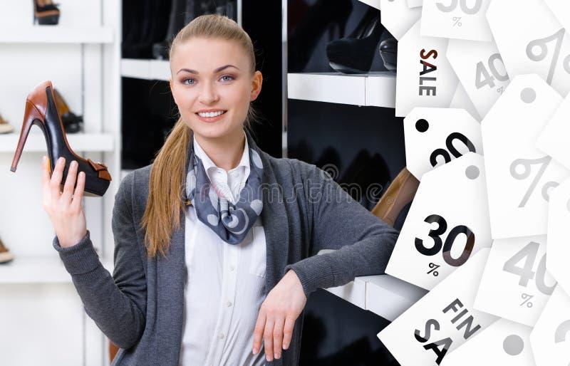 Woman chooses stylish pumps on sale stock photos
