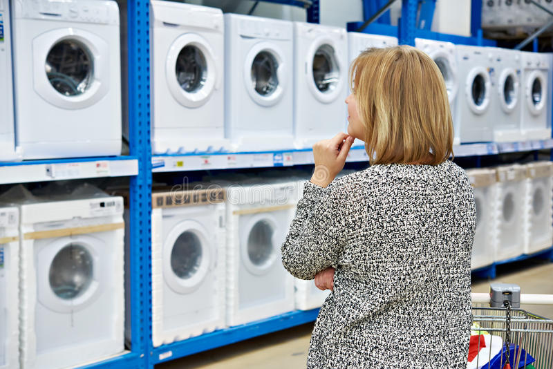 Woman Chooses Washing Machine Shop Home Appliances Stock