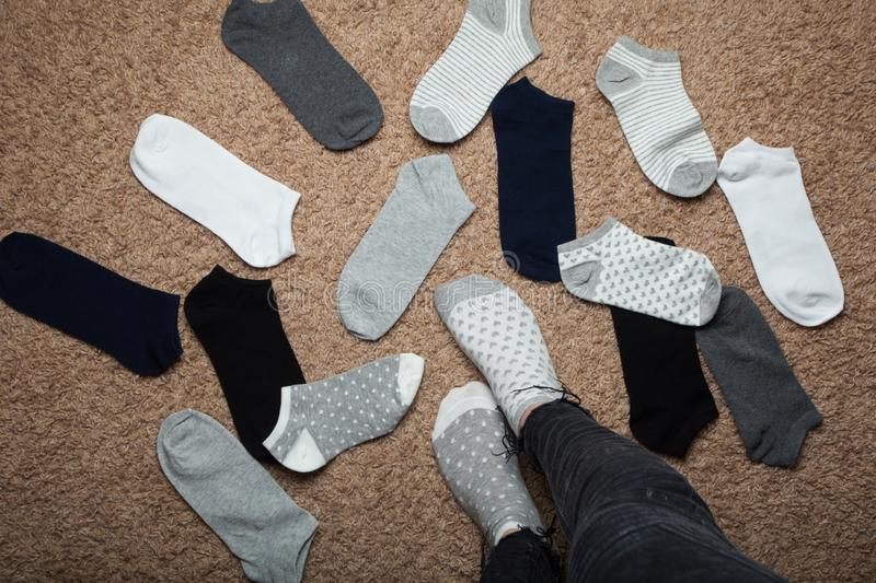 The woman chooses which socks to wear royalty free stock photo