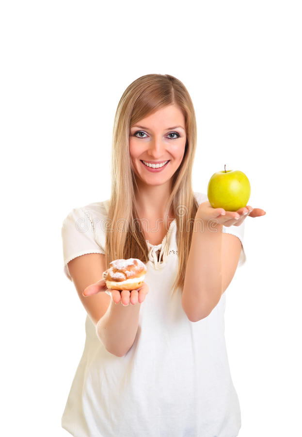 Download Woman Choosing Apple Over Puff Stock Photo - Image: 18519502