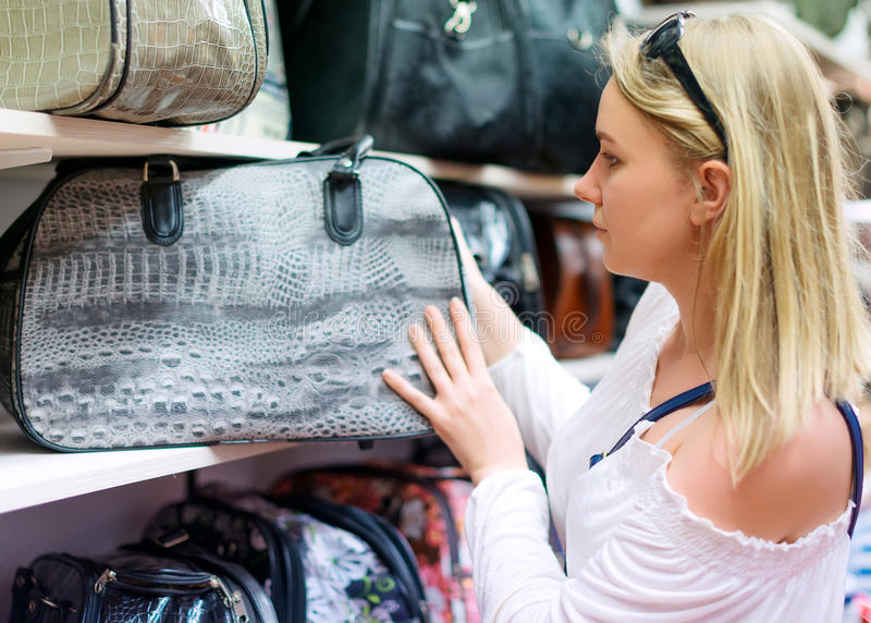 Woman choosing bag. stock image