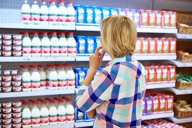 Woman choosing dairy products stock photography