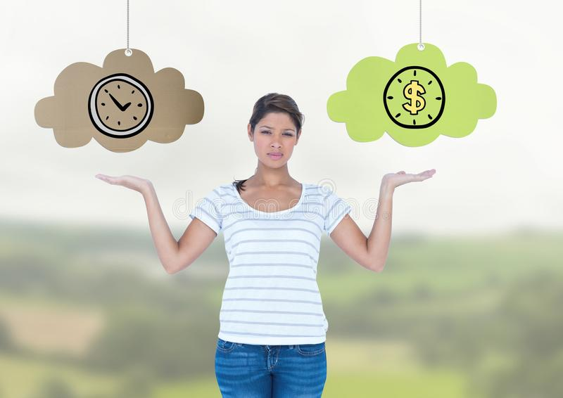 Woman choosing or deciding clouds of time or money with open palm hands stock images