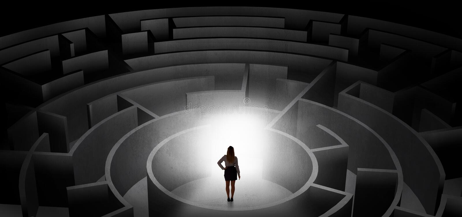 Woman choosing between entrances in a middle of a dark maze. Woman can not decide which entrance to chose in a middle of a dark maze royalty free stock photos