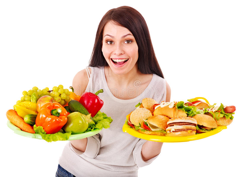 Woman choosing between fruit and hamburger. Isolated royalty free stock photo