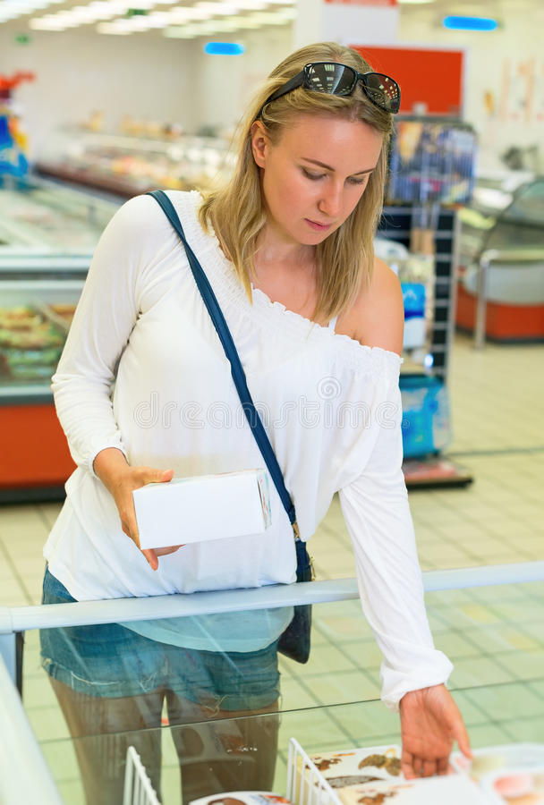 Woman choosing ice-cream. stock image
