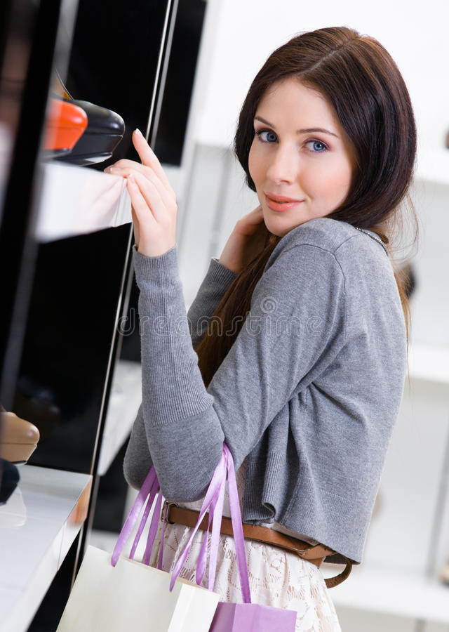 Download Woman Choosing A Pair Of Footwear In Shop Stock Photo - Image: 35655282