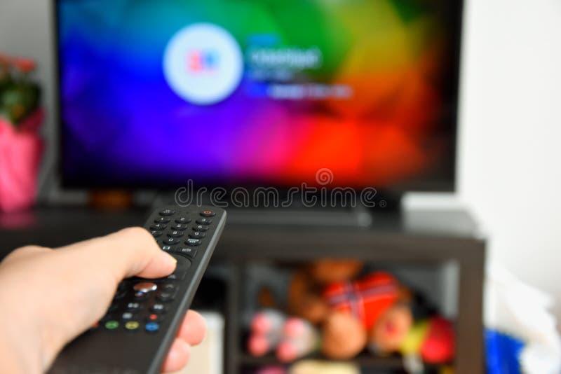 Woman choosing tv program royalty free stock images