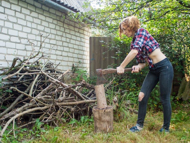 woman-chopping-wood-serious-countryside-44078974.jpg