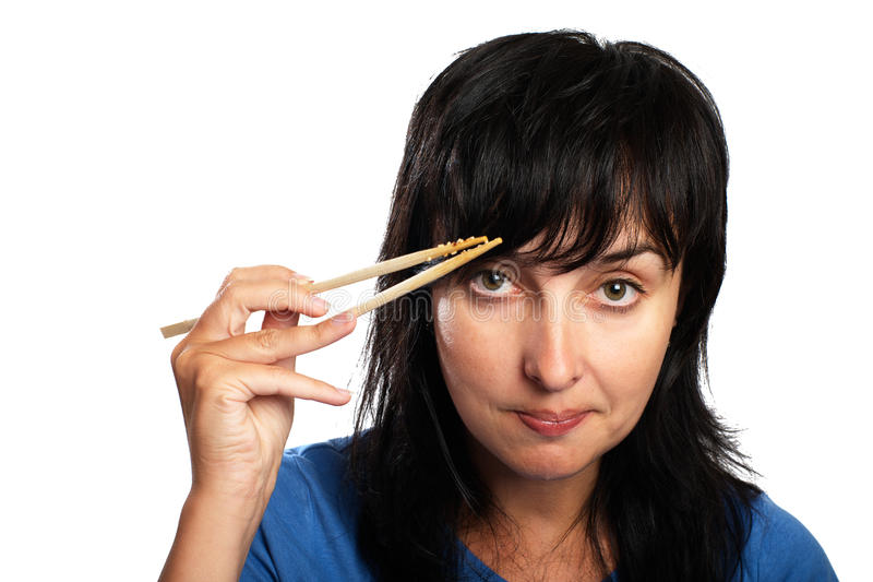 Woman with chopsticks royalty free stock photography