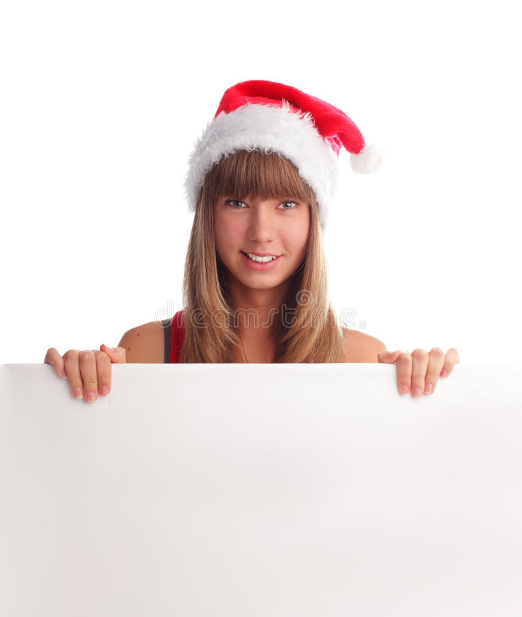 Woman in Christmas cap and blank in hands royalty free stock image