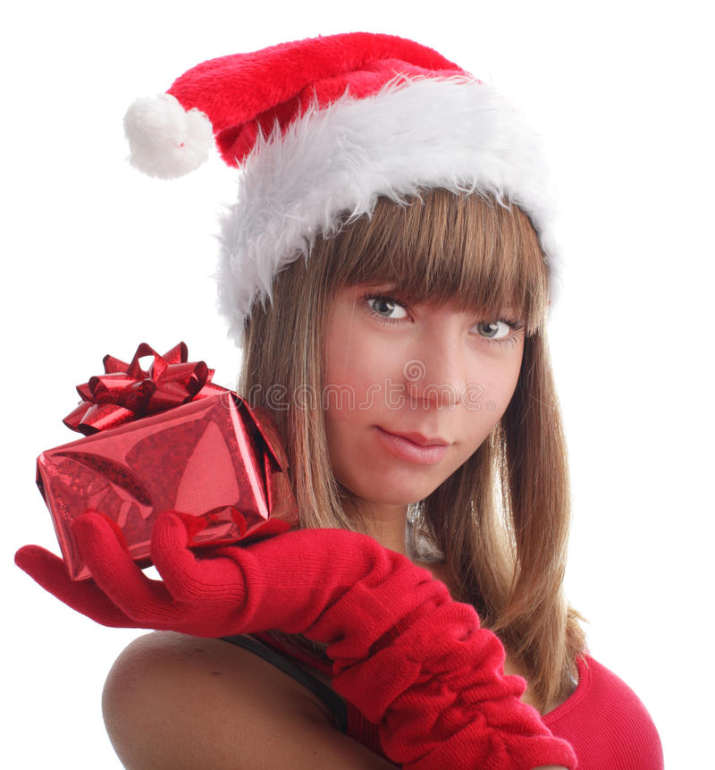 Woman in a Christmas cap with a gift stock images