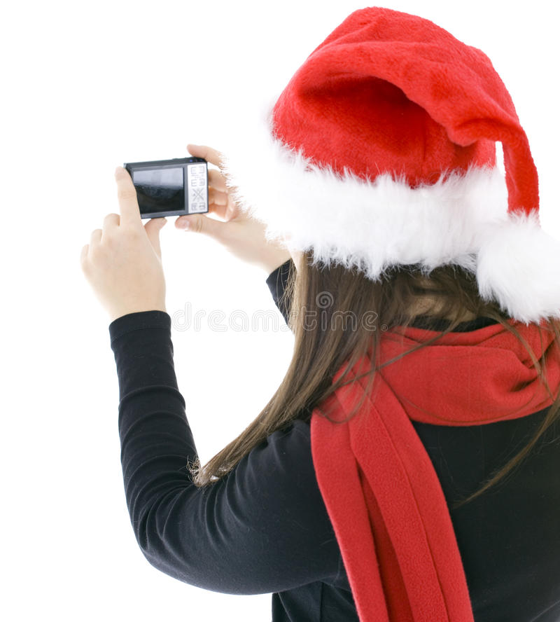 Download Woman In Christmas Cap Keeping Digital Camera Royalty Free Stock Images - Image: 14292559