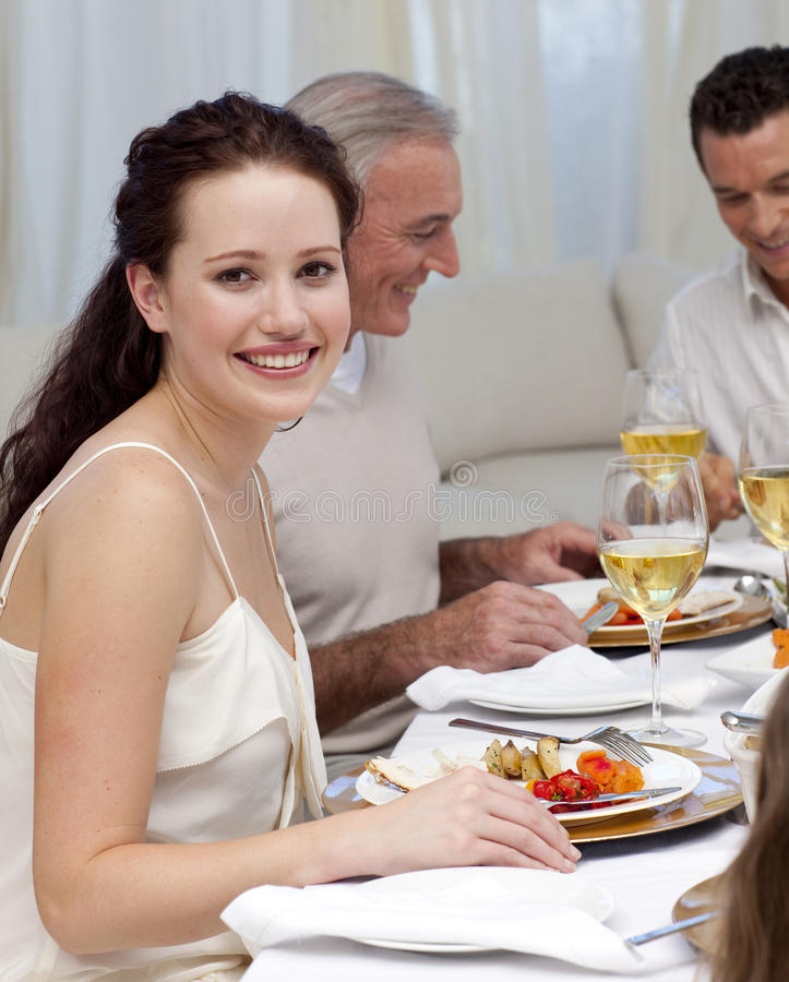 Woman In Christmas Dinner With Her Family Royalty Free Stock Images