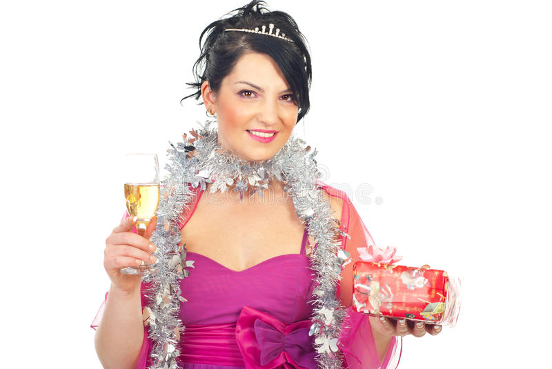 Woman with Christmas gift and champagne. Beautiful elegant woman celebrating Christmas and holding a present and a glass with champagne isolated on white royalty free stock image