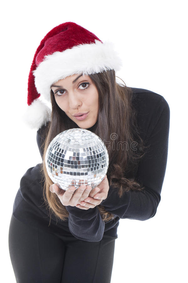 Woman with christmas hat with ball on hands stock photo