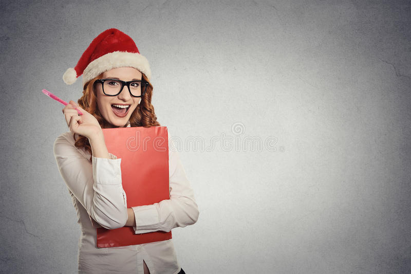 Woman with christmas hat is posing in studio thinking of gift ideas stock photos