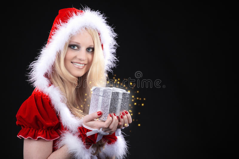 Woman with Christmas hat stock photography