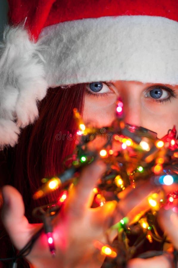 Woman With Christmas Lights Stock Photos