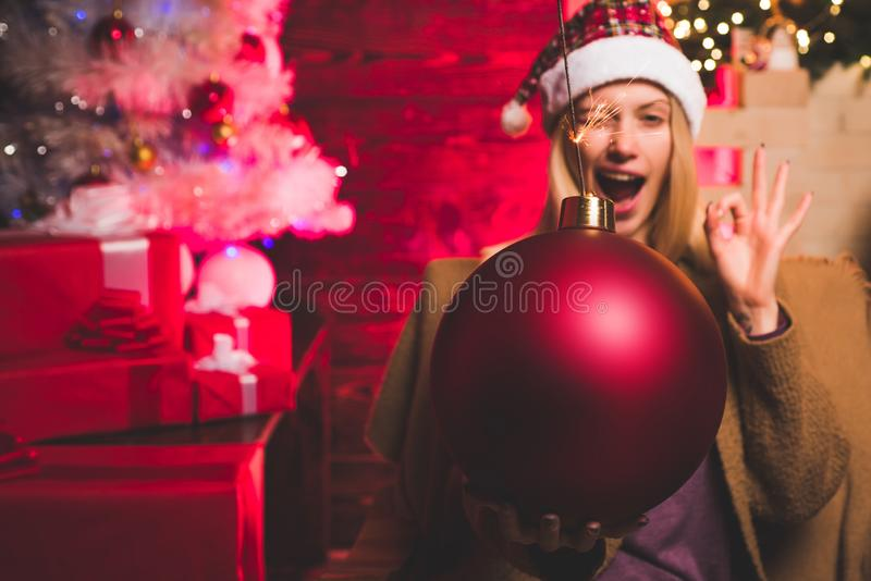 Woman Christmas. New year girl. Funny girl in Santa costume. Christmas sale. Bomb text copy space. Christmas Santa girl royalty free stock photos
