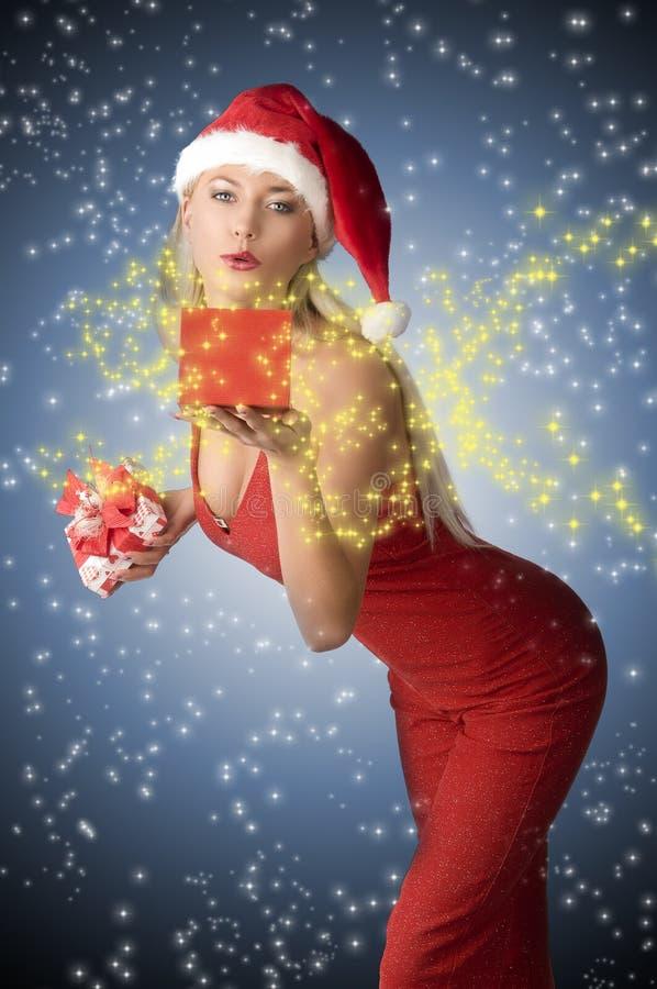 Woman with christmas present stock photo