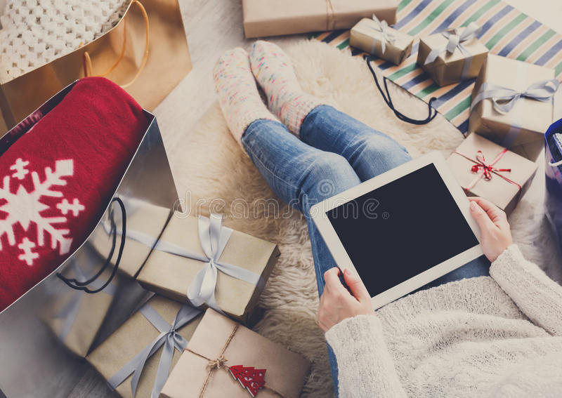 Woman christmas shopping online with tablet stock photo