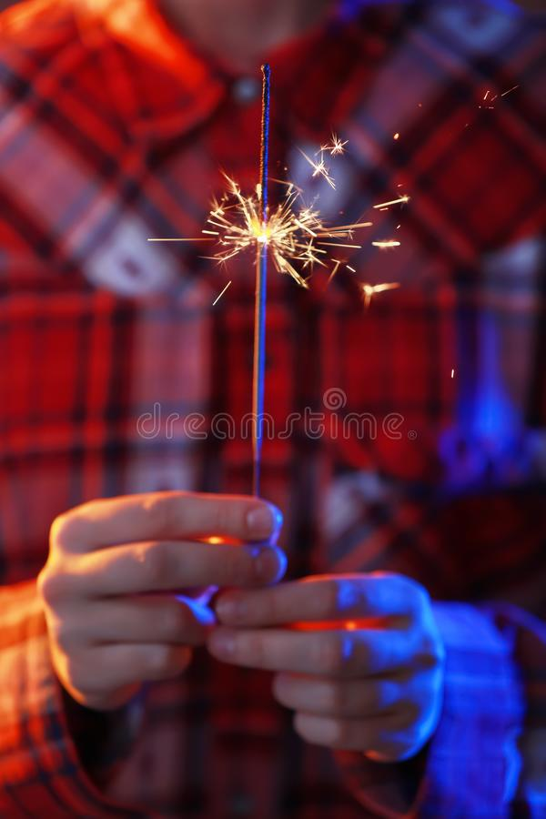 Woman with Christmas sparkler, closeup stock images