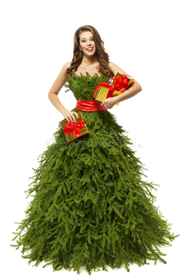 Woman Christmas Tree Dress, Fashion Model Girl Presents on White. Woman Christmas Tree Dress, Fashion Model Girl and Xmas Present Gifts, Green Clothes on White royalty free stock photos