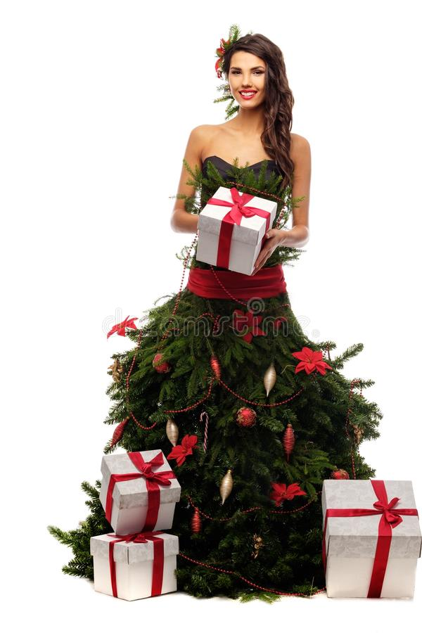 Woman in christmas tree dress. With gift box isolated on white stock photos