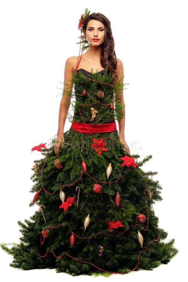 Woman in christmas tree dress. Isolated on white royalty free stock photos