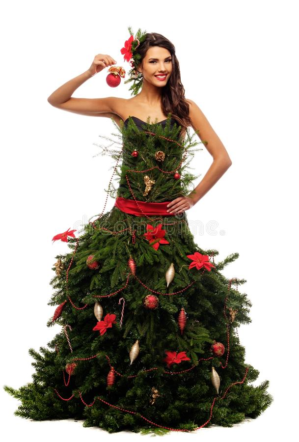 Woman in christmas tree dress. Isolated on white royalty free stock image