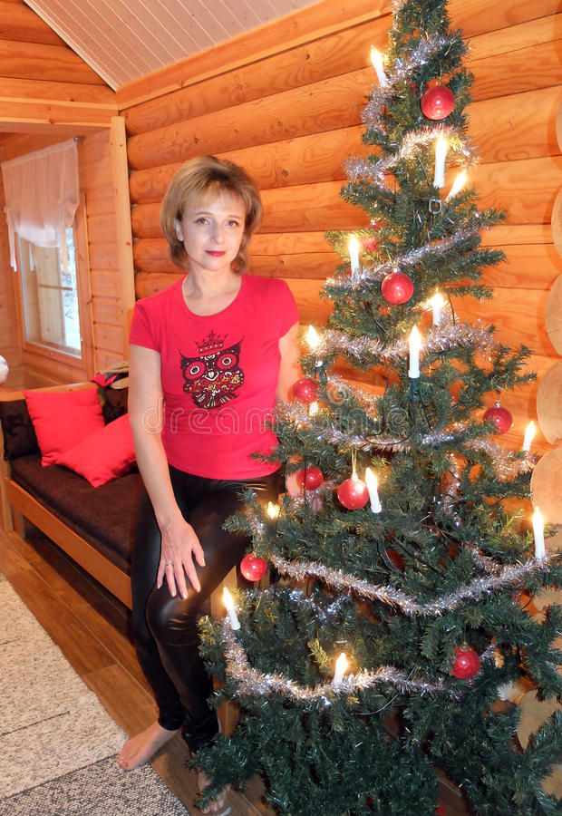 Woman at the Christmas tree. The woman at the Christmas tree in the hotel Spa. Finland stock photo