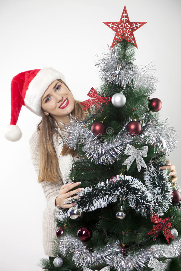 Woman with christmas tree. Pretty woman with christmas tree royalty free stock images