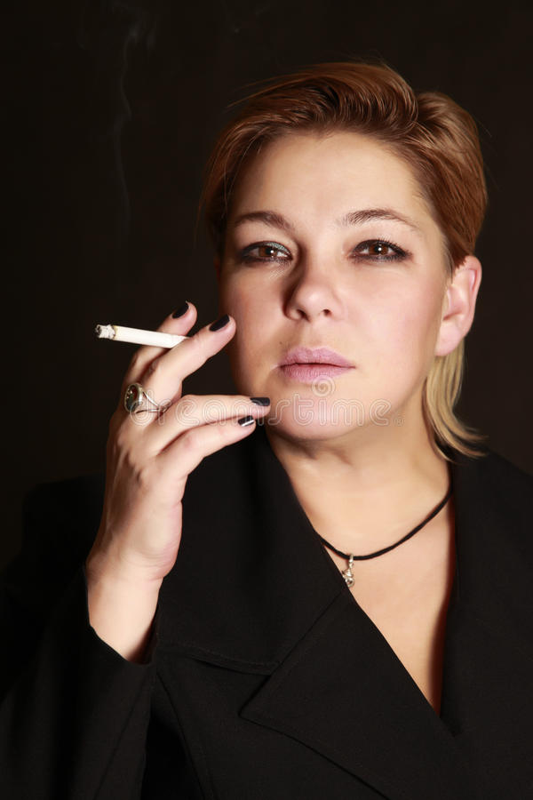 Woman with a cigarette royalty free stock photography