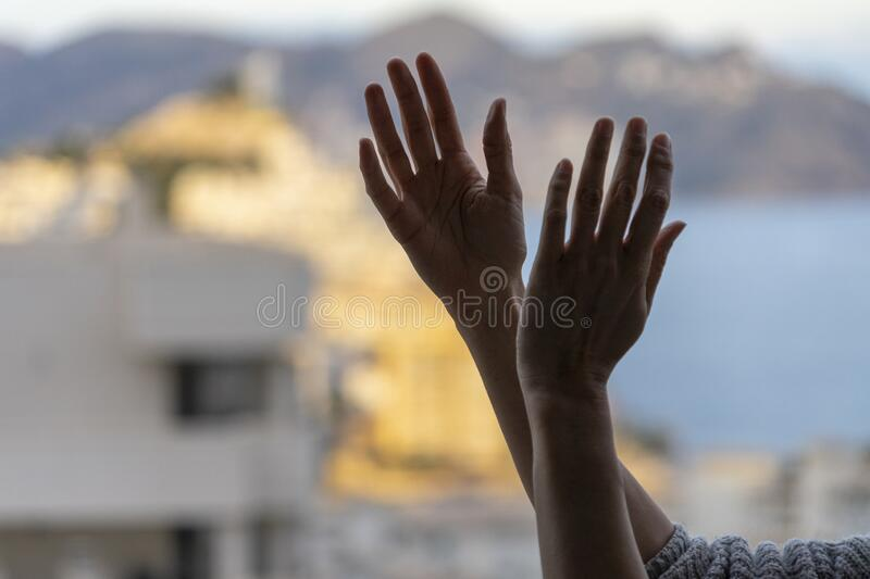 Woman clapping hands, applauding from balcony to support doctors, nurses, hospital workers, medical staff during. Applause. Woman clapping hands, applauding from stock photos