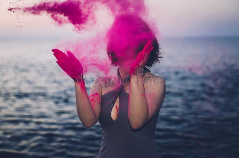 Woman clapping hands with Holi Powder stock photo
