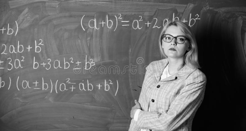 Woman in classroom. teacher on school lesson at blackboard. Back to school. Teachers day. Study and education. Modern. School. Knowledge day. Confident in their royalty free stock photo