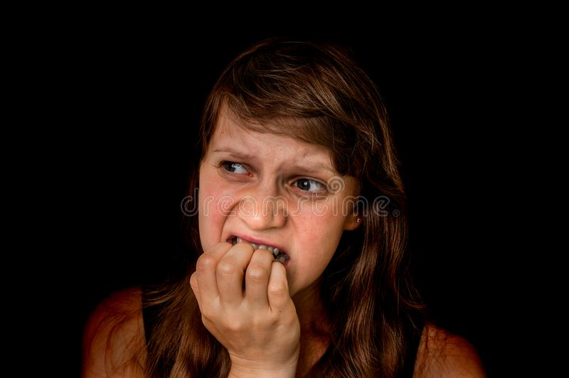 Woman with claustrophobia is alone in the dark place stock image