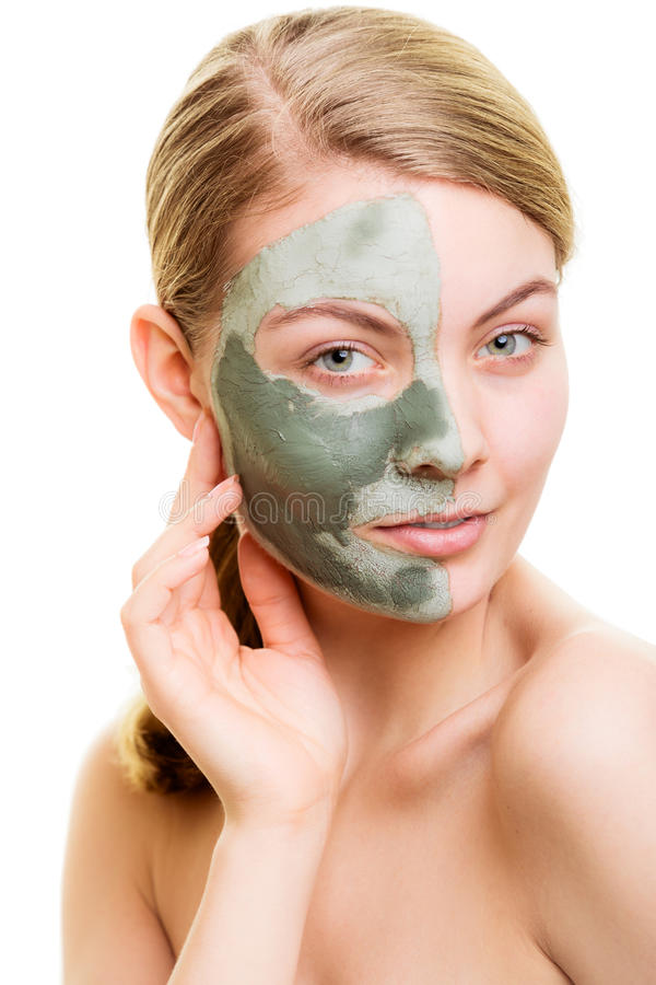 Woman in clay mud mask on face isolated on white. Skin care. Woman in clay mud mask on face isolated on white. Girl taking care of dry complexion. Beauty royalty free stock photo