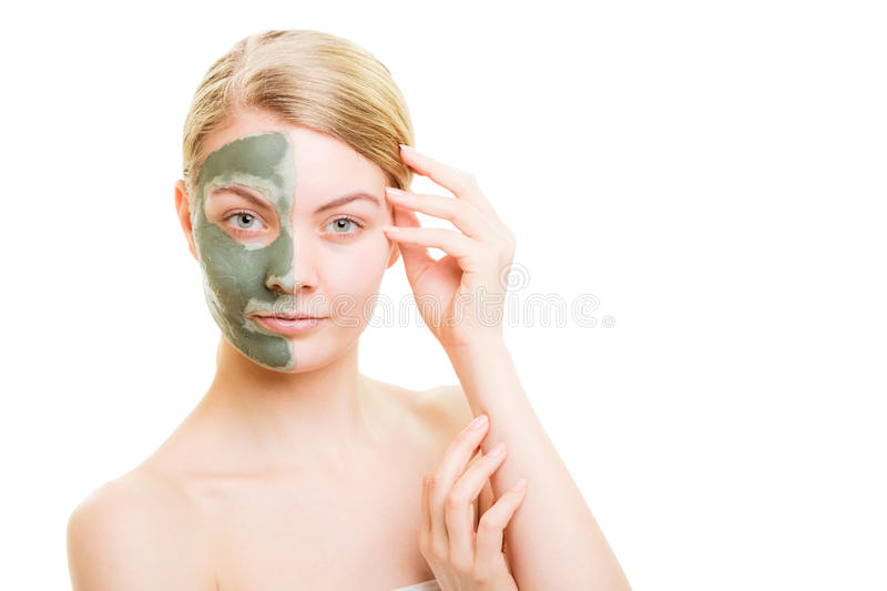 Woman in clay mud mask on face isolated on white. Skin care. Woman in clay mud mask on face isolated on white. Girl taking care of dry complexion. Beauty royalty free stock photos