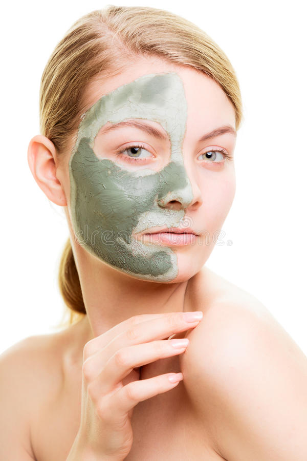 Woman in clay mud mask on face isolated on white. Skin care. Woman in clay mud mask on face isolated on white. Girl taking care of dry complexion. Beauty royalty free stock images