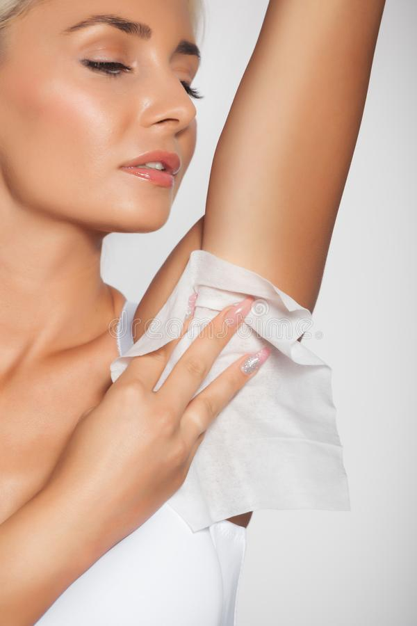 Woman clean the armpit with wet wipes royalty free stock photos