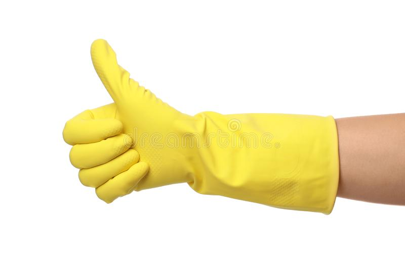 Woman in clean rubber glove for dish washing showing thumb up gesture royalty free stock photography
