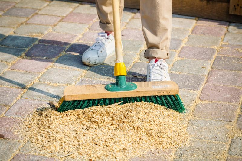 Woman clean up yard royalty free stock photography