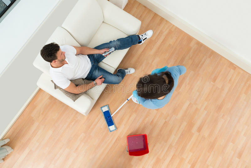 Woman cleaning floor stock photo