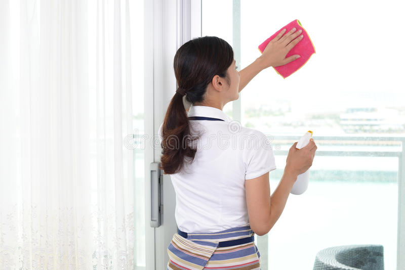 Woman cleaning the house. Asian woman cleaning the house stock images
