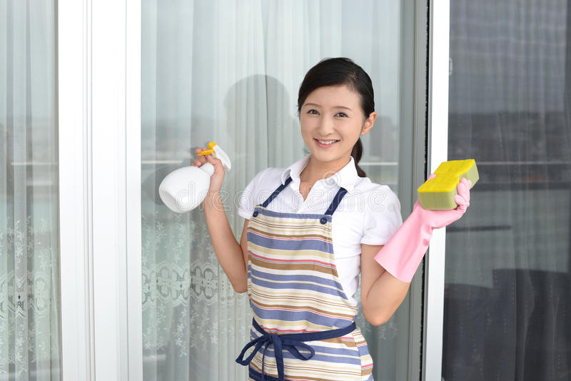 Woman cleaning the house. Asian woman cleaning the house stock photography