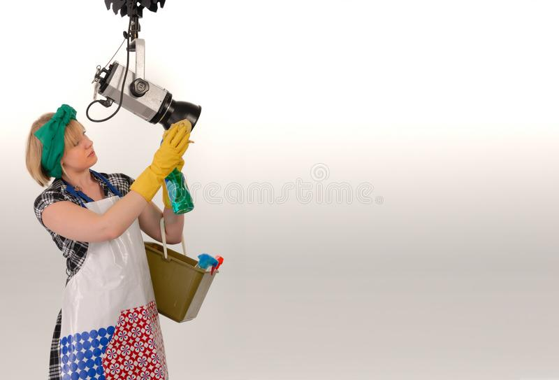 Woman cleaning photo studio royalty free stock images