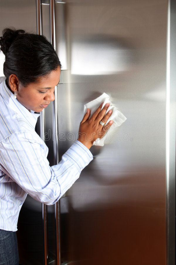 Woman Cleaning Refrigerator royalty free stock photos