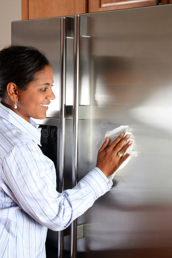Woman Cleaning Refrigerator royalty free stock images